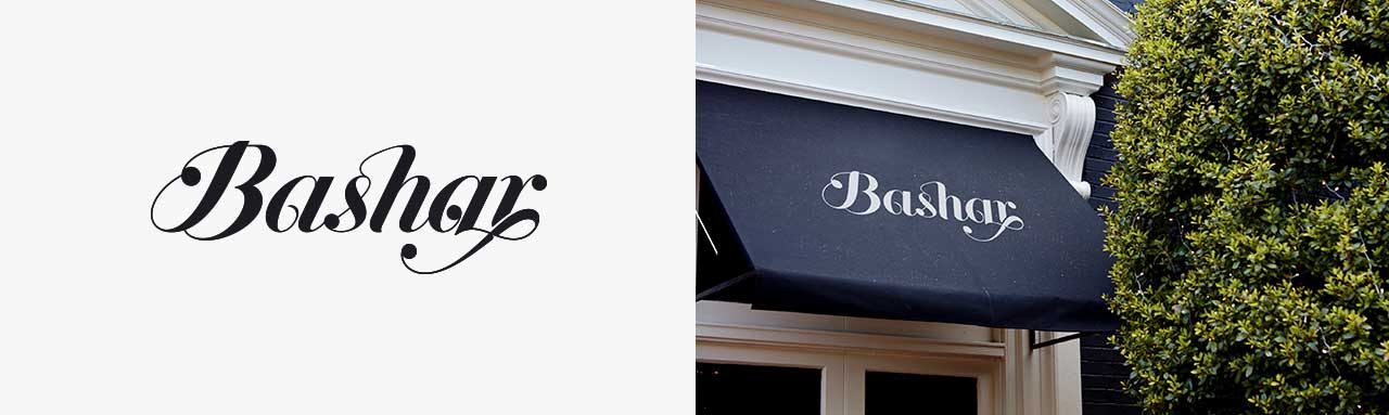 black and white logo design and white logo on awning
